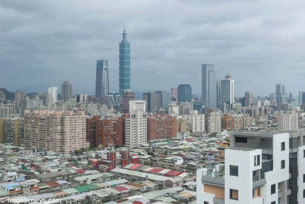 Taipei 101 stands tall amid the grid-clustered city